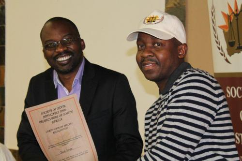 JACOB SEREPO RECEIVING A SPECIAL RECOGNITION CERTIFICATE FROM THE MINISTER OF JUSTICE AND CORRECTIONAL SERVICES